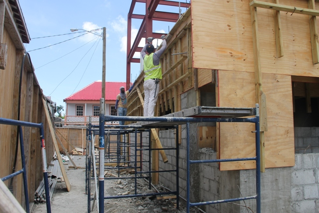 Local masons working on the first floor of the new Treasury building under construction in Charlestown on April 10, 2018