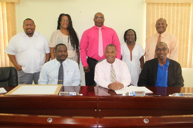 (l-r sitting) Mr. Keith Glasgow, Permanent Secretary in the Ministry of Culture; Hon. Eric Evelyn, Minister of Culture; Mr. Stanley Knight, Permanent Secretary in the Ministry of Culture in St. Kitts (l-r standing): Mr. Nigel Encalada, United Nations Educational, Scientific and Cultural Organization's Global Facilitator; Ms. Marlene Phillips, Research and Documentation Specialist in the St. Kitts Ministry of Culture; Ms. Pauline Ngungiri, Deputy Director of the Nevis Historical and Conservation Society and Mr. Jerome Rawlins, Chief Executive Officer of the Nevis Cultural Development Foundation at the Ministry of Finance conference room on April 10, 2018