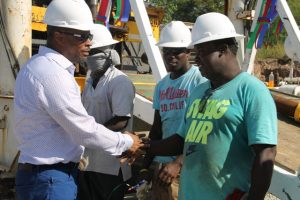 Then Acting Premier of Nevis Hon. Mark Brantley interacting with local workers at Hamilton Estate at the ribbon cutting ceremony to mark the start of drilling a test well in the geothermal development project (file photo)