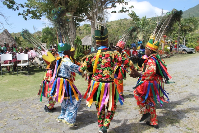 Primary school Masqueraders performing at the Nevisian Heritage Village at Fothergills in Gingerland