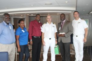 (L-R) Mr. Ken Pemberton, Port Manager in the Nevis Air and Sea Ports Authority, Ms. Tessa Manners, Representative from the Ministry of Tourism in the Nevis Island Administration, Mr. Devon Liburd, Director of Sales and Marketing at the Nevis Tourism Authority, Captain of the MV Silver Muse Marco Sangiscomo, Mr. Greg Phillip, Chief Executive Officer in the Nevis Tourism Authority and Mr. Jimmy Kovel, Cruise Director on the MV Silver Muse on board the ship docked in the Charlestown Port during its inaugural visit on April 06, 2018