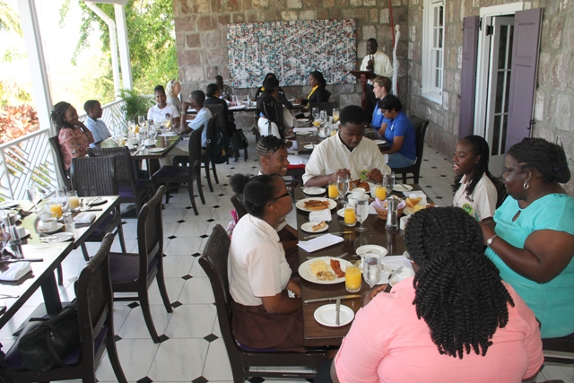 Mr. John Hanley, Acting Permanent Secretary in the Ministry of Tourism addressing the students at the breakfast launch of The Bank of Nevis Limited Tourism Youth Congress at the Montpelier Plantation and Beach Club on April 18, 2018