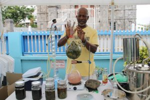 Mr. Evan Nisbett, one of the participants producing hydrosols from avocado pear leaves at the expo on May 23, 2018, at the end of the Essential Oils Workshop, hosted by the Small Enterprise Development Unit in the Ministry of Finance on Nevis