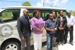 (l-r) Mr. Timothy Caines, Member of the St. Christopher and Nevis Social Security Board; Hon. Hazel Brandy-Williams, Minister of Health; Mr. William Perkins, driver in the Ministry of Health; Mrs. Nicole Slack-Liburd, Permanent Secretary in the Ministry of Health; Dr. Judy Nisbett, Medical Officer of Health and Mr. Vernel Powell, Assistant Director of the Social Security Board at the handing over ceremony of Toyota Hiace Bus and EKG machine to the Ministry of Health on May 18, 2018 at the Social Security Building in Nevis