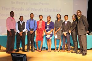 (l-r) Pheon Jones, Marketing Offer at the Bank of Nevis; Mr. Mikkel Maloney and Mr. Recardoe Rodriques, participants of the Charlestown Secondary School; Ms. Shai-Ann Tyson and Ms. K-Tara Huggins, participants of the Gingerland Secondary School; Ms. Eliyse Thomas and Mr. Kephra Grandison participants of the Nevis International Secondary School; Ms. Oksana Williams, Tourism Youth Congress Coordinator; and Mr. John Hanley, Acting Permanent Secretary in the Ministry of Tourism at the 11th staging of the Bank of Nevis Ltd. Tourism Youth Congress on May 17, 2018 at the Nevis Performing Arts Centre