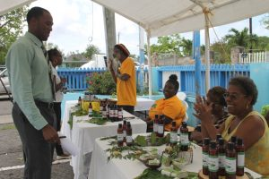 Participants introducing their finished products to the public at the end of a two-week Essential Oils Workshop, hosted by the Small Enterprise Development Unit in the Ministry of Finance on Nevis at a mini expo in Charlestown on May 23, 2018