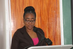 Mrs. Catherine Forbes, Development Officer at the Small Business Enterprise Unit delivering remarks at the opening ceremony of the Essential Oils Workshop on May 09, 2018, at the Credit Union Conference Room