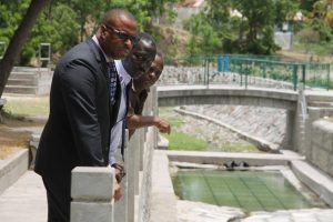(l-r) Hon Mark Brantley, Premier of Nevis and Minister of Finance, Mr. John Hanley, Acting Permanent secretary in the Ministry of Tourism and Mr. David Joseph of the Friends of Bath volunteer group looking at the completed Bath Stream renovations at a site visit on June 25, 2018