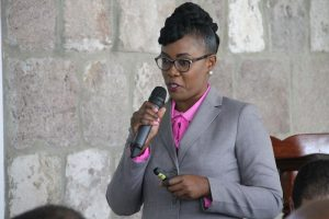 Ms. Kimone Moving, Director of the Nevis Investment Promotion Agency addressing members of the St. Kitts and Nevis Diaspora at the Premier's Business Breakfast at the Montpelier Plantation and Beach Club on Thursday, June 28, 2018