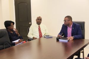 (l-r) Rev. Salome James, President of the Evangelical Association; Mr. Stedmond Tross, Cabinet Secretary and Senior Advisor to the Premier; and Hon. Mark Brantley, Premier of Nevis, during a meeting facilitated by the Premier with members of the Nevis Christian Council and the Evangelical Association on June 19, 2018 at the Premier's Ministry Conference Room at the Social Security Building at Pinney's Estate