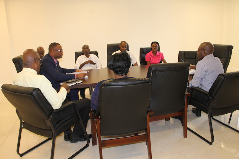 (centre) Hon. Mark Brantley, Premier of Nevis; (left) Mr. Stedmond Tross, Cabinet Secretary and Senior Advisor to the Premier; (left) Mr. Wakely Daniel, Permanent Secretary in the Premier's Ministry, meet with members of the Nevis Christian Council and the Evangelical Association on June 19, 2018 at the Premier's Ministry Conference Room at the Social Security Building at Pinney's Estate.