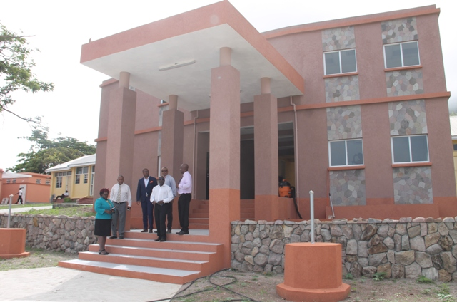 Cabinet members of the Nevis Island Administration on the steps of the new office complex at the Gingerland Secondary School during a tour of the facility on July 06, 2018