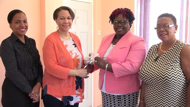 (l-r middle) Mrs. Coleen June Howell-Emanuel hands over gift of assorted breathing masks to Junior Minister of Health Hon. Hazel Brandy-Williams at her office in Charlestown on June 05, 2018. Looking on are Mrs. Nichole Slack-Liburd, Permanent Secretary in the Ministry of Health (extreme left) and Ms. Tessa Howell (extreme right)
