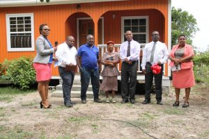 (l-r) Ms. Shelly Liburd, who oversees community housing assistance projects in the Ministry of Social Development; Pastor Ron Daniel, Hillary Shield; Ms. Lorraine Cassandra Phillip; Hon. Eric Evelyn, Minister of Social Development in Nevis; and Mr. Keith Glasgow, Permanent Secretary in the Ministry of Social Development at a ceremony to hand over a house to Ms. Phillip on June 14, 2018