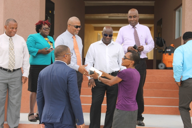 Members of the Nevis Island Administration Cabinet (l-r) Hon. Eric Evelyn, Hon. Hazel Brandy-Williams, Hon. Spencer Brand, Hon. Alexis Jeffers, Deputy Premier; Mr. Stedmond Tross, Cabinet Secretary; Hon. Troy Liburd and (first row) Hon. Mark Brantley, Premier of Nevis with Mrs. Lineth Williams, Principle of the Gingerland Secondary School while visiting the school's new office complex on June 06, 2018