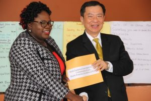His Excellency George Gow-Wei Chiou, Republic of China (Taiwan) Resident Ambassador to St. Kitts and Nevis presents Hon. Hazel Brandy-Williams, Junior Minister of Health with a cheque on June 12, 2018 at the Franklin Browne Community Centre in Newcastle  to purchase media equipment  for the Health Promotion Unit