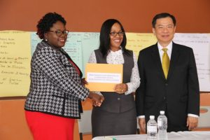 (l-r) Hon. Hazel Brandy-Williams, Junior Minister of Health in the Nevis Island Administration hands over cheque from the Republic of China (Taiwan) on June 12, 2018, at the Franklin Browne Community Centre in Newcastle to Mrs. Nicole Slack-Liburd, Permanent Secretary in the Ministry of Health while His Excellency George Gow-Wei, Ambassador of the Republic of China (Taiwan) to St. Kitts and Nevis looks on