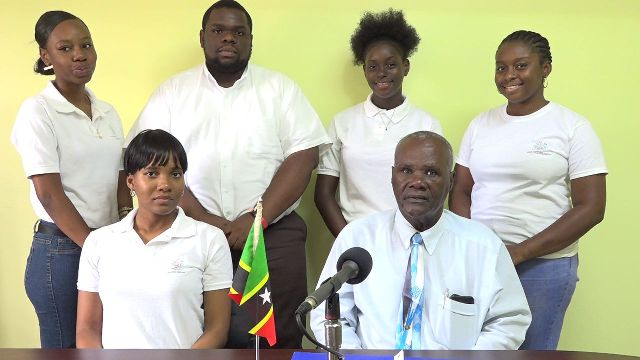 Hon. Farrel Smithen, President of the Nevis Island Assembly, introducing Youth Parliamentarians taking part in the 14th Regional Youth Parliament Debate in the Cayman Islands on Friday June 22, 2018; (sitting left) Ms. Uta Taylor, chaperon; (standing l-r) Ms. Celestial Hanley, Mr. Rol-J Williams, Ms. Charlyn Myers and Ms. Lauren Lawrence