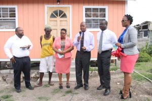 (l-r) Pastor Ron Daniel, Mr. Joseph Belgrave, Ms. Joyce Moven, Deputy Director at the Department of Social Services, Hon. Eric Evelyn, Minister of Social Development on Nevis, Mr. Keith Glasgow, Permanent Secretary in the Ministry of Social Development and Mrs. Shelly Liburd who oversees community housing assistance projects at the handing over ceremony of a new home to Mr. Belgrave at Spring Hill on June 14, 2018