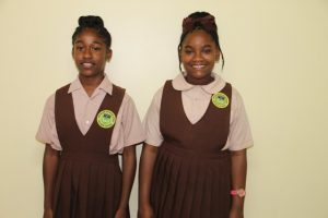 Winners of the local leg of the 2018 Florida Caribbean Cruise Association Essay Contest on Nevis: (l-r) Ms. Jareecia Browne, winner in the Senior Category; and Dericia Williams, winner in the Junior Category; both students are from the Gingerland Secondary School