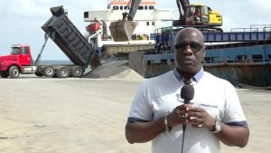 Hon. Alexis Jeffers, Acting Premier of Nevis and Minister responsible for Natural Resources in the Nevis Island Administration, at the Long Point Port witnessing a barge from Guyana loading aggregate at the Long Point Port on July, 17, 2018