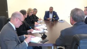 Hon. Mark Brantley, Premier of Nevis and Mrs. Hélène Ann Lewis, Legal Adviser to the NIA (to his immediate left) meeting with representatives of the Overseas Private Investment Corporation (OPIC) based in Washington (left), and geothermal developers of Nevis Renewable Energy International (right) at his office at Pinney's Estate on July 30, 2018