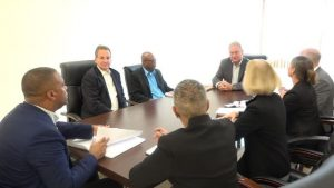 Another view of Hon. Mark Brantley, Premier of Nevis and Mrs. Hélène Ann Lewis, Legal Adviser to the NIA (to his immediate right) meeting with representatives of the Overseas Private Investment Corporation (OPIC) based in Washington (left), and geothermal developers of Nevis Renewable Energy International (right) at his office at Pinney's Estate on July 30, 2018