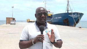Hon. Alexis Jeffers, Minister of Natural Resources on Nevis and Chairman of the Nevis Housing and Land Development Corporation Board of Directors, at the Long Point Port on August 17, 2018 where a barge is loading up for the second time with aggregate from Nevis bound for Guyana