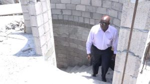 Hon. Alexis Jeffers, Deputy Premier of Nevis and Area Representative for the St. James Parish on the stairway from the ground floor to during his visit at the construction site of the new Newcastle Police Station on August 22, 2018