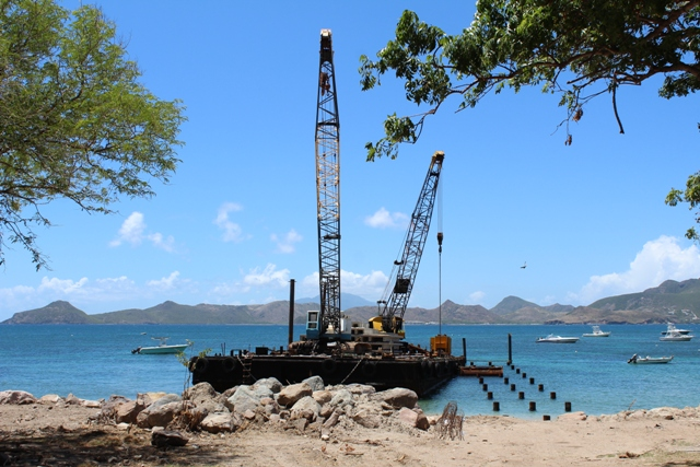 Work on the new state-of-the-art water taxi pier at Oualie Bay on August 23, 2018, with the barge and 200ft of piles planted offshore for the 300ft facility