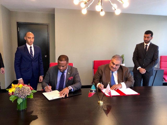 Foreign Minister of St. Kitts and Nevis Hon. Mark Brantley and His Excellency Khalid bin Ahmed bin Mohammed Al Khalifa, Minister of Foreign Affairs of Bahrain sign agreement establishing diplomatic relations with the Kingdom of Bahrain