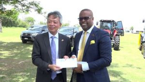 Republic of China (Taiwan) Resident Ambassador to St. Kitts and Nevis His Excellency Tom Lee, on behalf of his government and people, hands over a cheque and keys to Hon Mark Brantley, Premier of Nevis at Pinney's Estate on August 28, 2018
