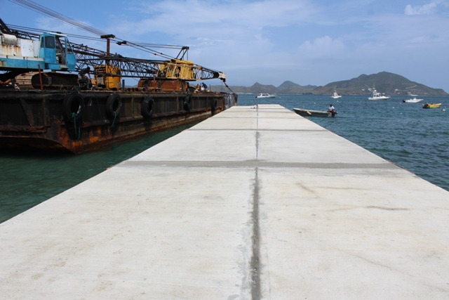 The new water taxi pier under construction at Oualie Bay on September 12, 2018, next to the barge being prepared for its departure from Nevis for its 10-hour journey to St. Marteen later in the day.