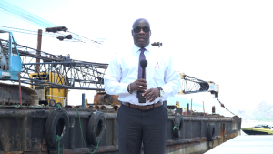 Hon. Alexis Jeffers, Deputy Premier of Nevis and Area Representative for the St. James' Parish at Oualie Bay on the new water taxi pier under construction on September 10, 2018