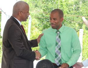 : Hon. Spencer Brand, Minister of Water Services on Nevis hands over keys to the pump station and wells at Maddens Estate to Mr. Roger Hanley, Manager of the Nevis Water Department, moments after receiving it from Mr. Michael Miville, Chief Executive Officer, of Bedrock Exploration and Development Technologies LLC at a handing over ceremony on October 05, 2018