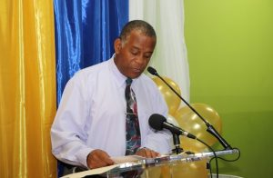 Hon. Eric Evelyn paying tribute to the late Mr. Brian Anthony David at a renaming ceremony by the Customs and Excise Department on Nevis on October 25, 2018, on the occasion of the 60th anniversary of the St. Kitts and Nevis Customs and Excise Department