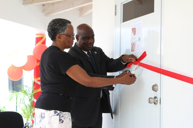 Hon. Alexis Jeffers, Deputy Premier of Nevis and Minister of Agriculture, cuts the ribbon to the new Processing Wing of the government-owned Abattoir at Prospect with Her Honour Hyleta Liburd, Deputy Governor General for Nevis at a commissioning ceremony on October 17, 2018