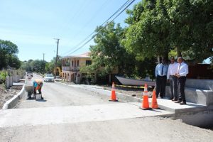 Section two of the first phase of the Brown Hill Road Rehabilitation Project is ready for asphalting with workers conducting finishing touches to the curb on October 31, 2018