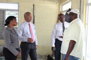 (Second from left) Hon. Spencer Brand, Minister of Communications and Works on Nevis' speaks with contractor (extreme right) Mr. Alton Brown at the Charlestown Primary School ongoing expansion project. Looking on are (extreme right) Ms. Latoya   Jeffers, Charlestown Primary School Principal, and (second from right) Dr. Ernie Stapleton, Permanent Secretary in the Ministry of Communication and Works