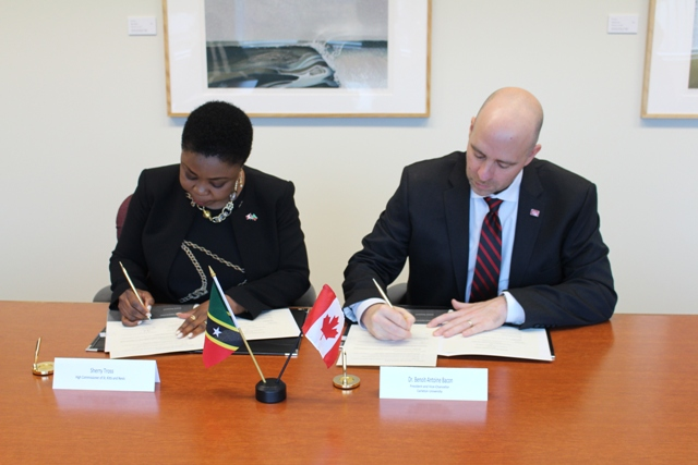 (l-r) Her Excellency Ms. Sherry Tross St. Kitts and Nevis High Commissioner to Canada and Dr. Benoit-Antoine Bacon, President and Vice Chancellor of Carleton University, sign a Memorandum of Understanding in Ottowa, Canada on November 01, 2018