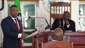 Hon. Mark Brantley, Premier of Nevis and Minister of Finance on Nevis, makes his presentation at the Nevis Island Assembly sitting to Hon. Farrel Smithen President of the Nevis Island Assembly on November 15, 2018, while Ms. Myra Williams, Clerk of the Assembly looks on