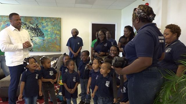 Hon. Mark Brantley, Premier of Nevis joins students of the Antioch Baptist Academy Pre-School in St. Kitts in singing a variety of Christmas Carols at his Pinney's Estate office on November 30, 2018