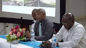 (L-r) Mr. Raoul Pemberton, Director of the Public Works Department; Hon. Spencer Brand, Minister of Communications and Works; and Dr. Ernie Stapleton, Permanent Secretary in the Ministry of Communication and Works; at a recent town hall meeting for residents of Craddock Road