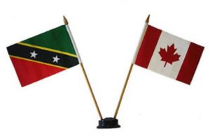 (l-r) Flags of St. Kitts and Nevis and Canada