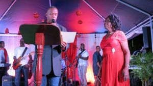 Hon. Eric Evelyn, Minister of Social Development, presenting a certificate of appreciation to Mrs. Zaiditor Olive Jeffers of Craddock Road at the annual Christmas Tree Lighting Ceremony in Charlestown on December 05, 2018