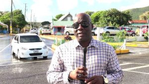 Hon. Alexis Jeffers Deputy Premier of Nevis and Area Representative for the St. James Parish standing at the entrance of Shaws Road in Newcastle on December 19, 2018