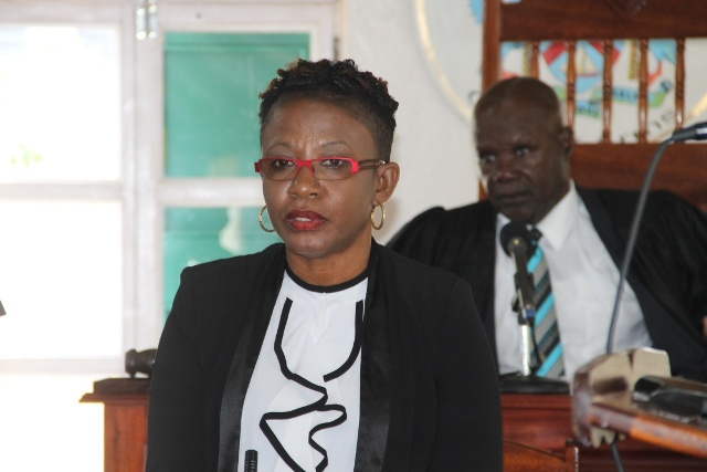 Ms. Myra Williams, Clerk of the Nevis Island Assembly at a sitting of the Nevis Island Assembly with Hon. Farrel Smithen President of the Assembly in the background (file photo)