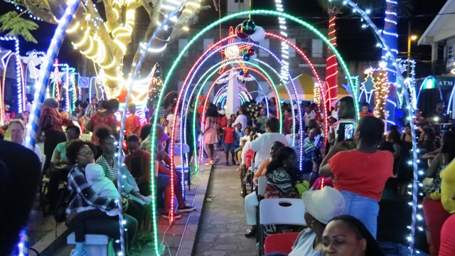 Members of the public savouring the start of the Christmas Season in Charlestown, moments after Mrs. Zaiditor Olive Jeffers of Craddock Road, Patron of the Department of Community Development's annual Christmas Tree Lighting Ceremony flipped the switch to light up the capital on December 05, 2018
