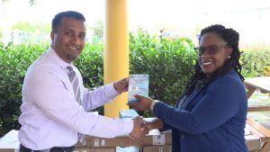 (L-r) Dr. Ravi Chinnaswamy, of the Nevis Dental Clinic hands gifts to Ms. Shinnelle Mills, Assistant Hospital Administrator on January 23, 2019, for use at the Flamboyant Nursing Home