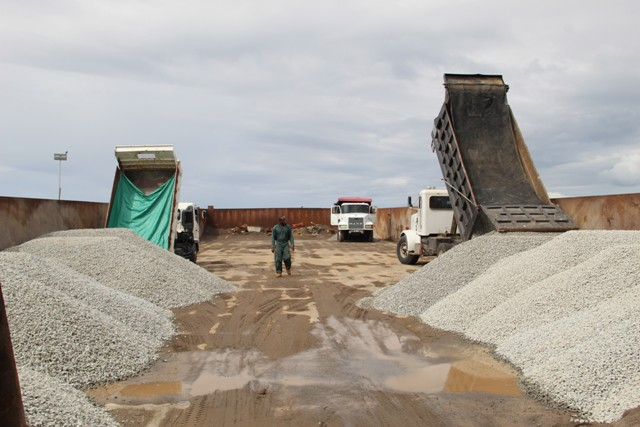 Truckers loading barge at Long Point Port bound for St. Kitts with aggregate from the government owned quarry at New River on January 16, 2019